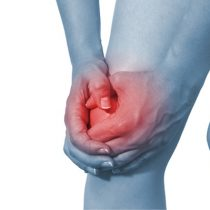 Acute pain in a woman knee. Isolation on a white background