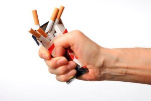 Isolated-shot-of-broken-cigarettes-on-white-background[1]