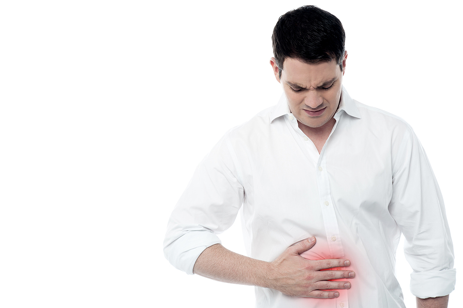 Stomach ache man placing hand on the spot.