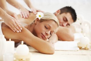 Young couple is having a back massage at the spa centre.